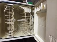 Kenmore Dishwasher, stove and refrigerator with ice