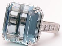 This handmade ring, crafted in 18k white gold,