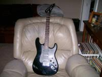 Nice condition strat copy with original case, strap,