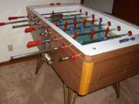 Antique Arcade Foosball table. Comes with many balls.
