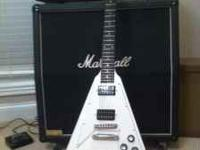 I'm selling this awesome Gibson Flying V. It is a