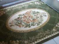 Nice area rug approximately 5 feet by 39 inches. Greens