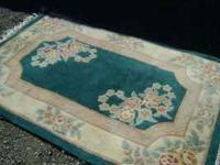 This rug is in great contition no stains. Measures 3'