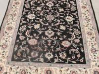"Beautiful area rug. 66"" X 50"" Must see to appreciate"