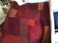 Red patterned rug for sell. Asking $150.00 obo. Bought