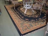 AREA RUG, BLUE VELOUR WITH GOLD, AND BROWN ACCENTS.