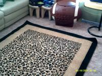 $50 - LEOPARD ANIMAL PRINT RUG. Rectangle form with