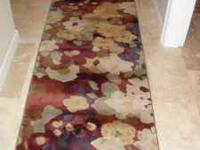 Brand new rugs....never used. 8x10 and 2 matching
