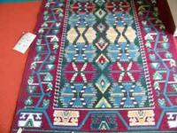 HAVE ABOUT 10 AREA RUGS ALL OF THEM ARE 24.99 EACH REG
