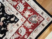 Beautiful 96x76 area rug in like new condition. It has