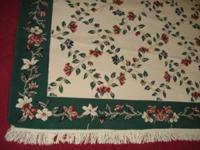 Good 5 x 7 rug, colors are green, cream & rust. Great