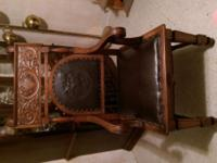 Beautiful Oak Antique Throne Chair displays Arethusa's