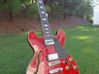 For sale is my used Aria TA-50 QM semi hollow (or