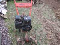 ARIENS 4 HP. ROTOTILER IT HAS A 4 HP. BRIGGS & STRATION