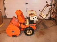 This is a Ariens 7hp snowblower with 24 inch cut. The