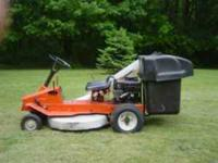 "Ariens riding mower. I believe it has a 30"" mower and"