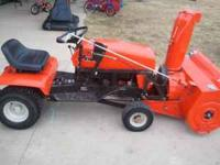 This is an Ariens 12 HP riding mower with a 2 stage