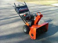 For sale is an Ariens ST824 snow blower with an 8hp