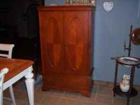 cherry finish tv armoir in excellent shape. call