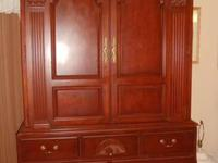 I have a georgeos Thomasville, solid wood Armoire for