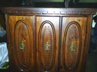 I have a Basset armoire in good condition,it has three