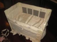 Nice condition arms reach co-sleeper. Has storage bag,