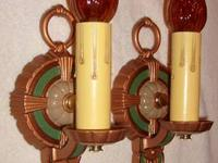 Here is a freshly restored pair of cast iron sconces