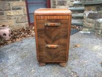 Classically lovely, this art deco style nightstand