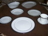 The set includes a bowl with lid, four tray or mirror