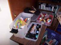 Boxes of art supplies. paints, brushes, apron, paper,