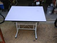 White Art table with resistant finish. Great for Young