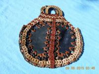 A used Artisan Leather Hand Bag. This item measures at