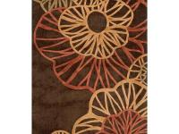 Machine tufted in 100% polyester, this rug features an