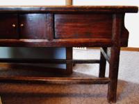 Older, primitive Oriental sideboard. This item is
