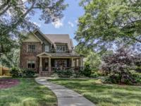 Beautiful brick and stone Craftsman style home with