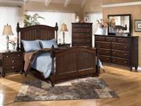 "The ""Camdyn"" bedroom collection uses a rich finish"
