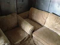 I am selling my Like new used green suede Ashley sofa