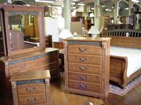 Oak 4 piece king size bedroom set made by Ashley in