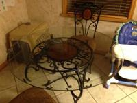 Glass top kitchen table set with 4 chairs.  Very Nice,
