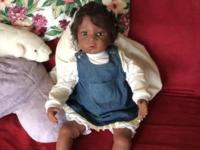 Lifelike doll. 25-26 inches long. Denim