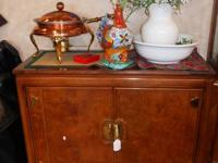 This charming piece is manufactured by Thomasville,