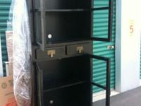 This Asian style cabinet with glass doors was purchased