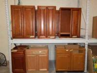 Assorted kitchen cabinets, both base, and wall style.