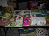 Assorted cat decor, books, photo albums, plates,
