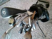 Up for sale are an assortment of golf clubs, two sets I