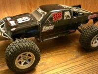I have some older RC cars for sale. A Losi Desert truck