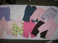 11 pair of girls pants ranging in size from newborn - 9