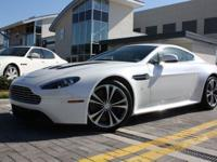 This 2011 Aston Martin V12 VANTAGE COUPE features a