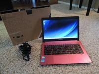 Asus Pink Laptop for sale. It has windows 8 , 14 inch