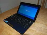Navy blue Asus netbook and charger. Just bought for